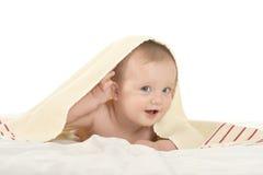 Baby boy lying under blanket Stock Photo