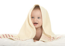 Baby boy lying under blanket Royalty Free Stock Images