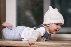 Baby boy lying in a white knitted cap Royalty Free Stock Photo