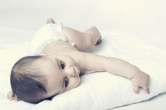 Baby boy lying on white towel Stock Photo
