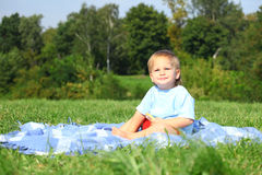 Baby boy on the meadow Royalty Free Stock Photo