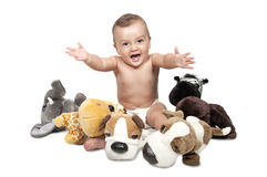 Baby boy in the middle of alot of stuffed animals. Stock Photo