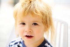 Baby boy with milk moustache Stock Photos