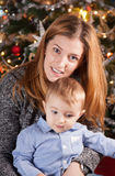 Baby boy and mommy, Christmas portrait Stock Image
