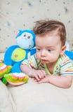Baby boy with monkey Stock Photo