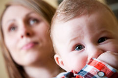 Baby boy with mother Stock Photos