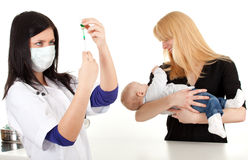 Baby boy with mother at doctor Royalty Free Stock Photography