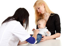 Baby boy with mother at doctor Stock Photo