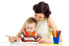 Baby boy and mother drawing Royalty Free Stock Photography