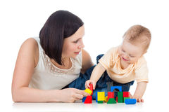 Baby boy and mother play. Ing together with construction set toy Royalty Free Stock Photos