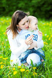 Baby boy with mother play. In park Royalty Free Stock Photos