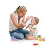 Baby boy and mother play. Ing together with construction set toy Stock Image