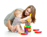 Baby boy and mother play pyramid toy Royalty Free Stock Photos