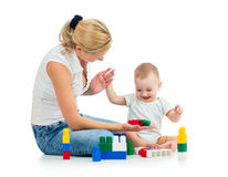 Baby boy and mother play together Stock Images