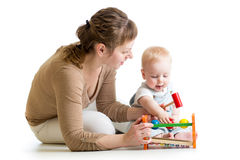 Baby boy and mother play together with toy Stock Image