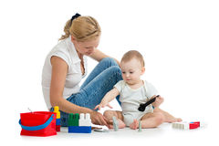 Baby boy and mother play together with toys. Baby boy and mother playing together with construction set toy Royalty Free Stock Photo