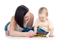 Baby boy and mother playing together Royalty Free Stock Images