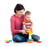 Baby boy and mother play Royalty Free Stock Image