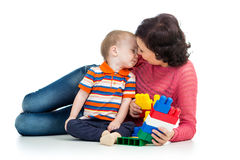 Baby boy and mother playing. Together with construction set toy Stock Images