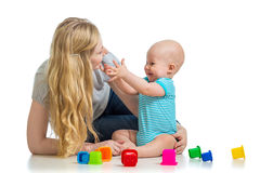 Baby boy and mother playing together with cup toys Stock Photo