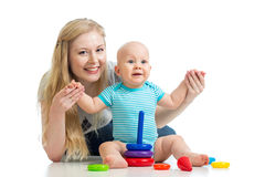Baby boy and mother playing together with toy Stock Images