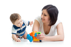 Baby boy and mother playing together with toy. Kid boy and mother playing together with toy Royalty Free Stock Photography