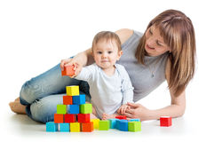 Baby boy and mother playing together with  toys. Baby boy and mother play together with  toys Royalty Free Stock Images