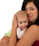 Baby boy in mother's arms Stock Image