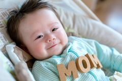Baby boy with Mother`s Day theme royalty free stock image