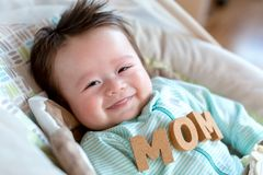 Baby boy with Mother`s Day theme stock photography