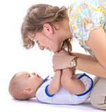 Baby boy and mother. Studio shot of baby boy and mother lying on white floor Royalty Free Stock Photo