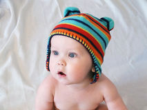 Baby boy in multicolored knitted cap Stock Images