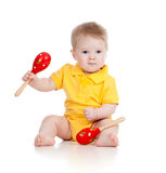 Baby boy with musical toys maracas Royalty Free Stock Photo