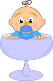 Baby boy with nipple in blue glass Royalty Free Stock Images