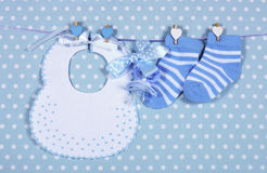 Baby boy nursery blue socks and bib Stock Photo