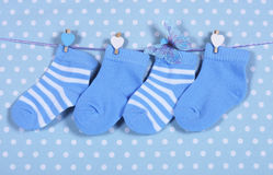 Baby boy nursery blue socks and butterfly Stock Photos