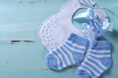 Baby boy nursery blue and white socks and bib Royalty Free Stock Photo