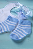 Baby boy nursery blue and white socks, bib - vertical Royalty Free Stock Image