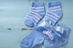 Baby boy nursery blue and white socks with copy space Stock Photos