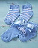 Baby boy nursery blue and white socks and dummy Stock Photography