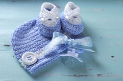 Baby boy nursery blue and white wool booties and bonnet Stock Image