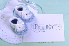 Baby boy nursery blue and white wool booties and card Stock Photos