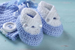 Baby boy nursery blue and white wool booties close up Stock Images