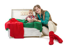 Baby boy in old box with his mother Stock Images