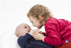 Baby boy with older sister Royalty Free Stock Photo