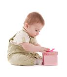 Baby boy open small pink gift box Royalty Free Stock Images