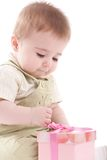 Baby boy open small pink gift box Royalty Free Stock Image