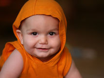 Baby boy in orange hoodie Stock Images