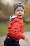 Baby boy in orange jacket Royalty Free Stock Photos