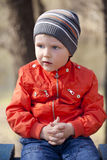 Baby boy in orange jaket and blue jeans Stock Photography